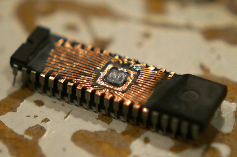 Last time I was at the lab I found this chip had been left on the work table for others to examine.  I believe the chip is a EPROM.