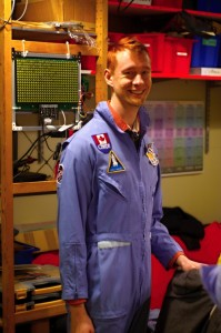 Eric wearing a flight suit.
